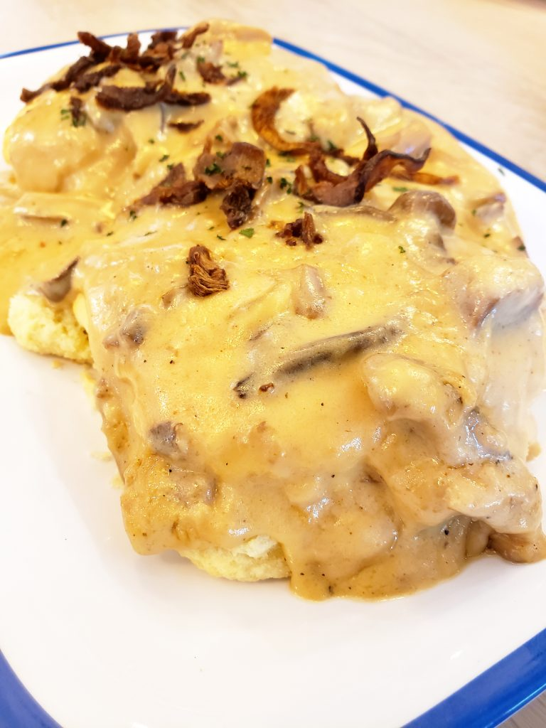 Soft, flaky biscuits covered with Frondosa Farms mushroom gravy and crispy mushrooms.